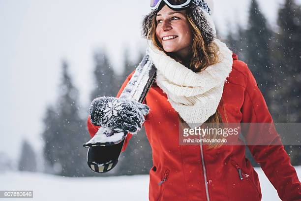 smiling skier enjoying the winter time - parka coat stock photos and pictures