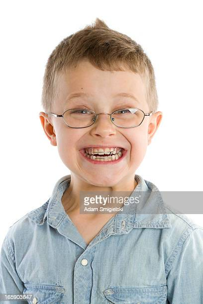 smiling smiling boy with braces isolated on white