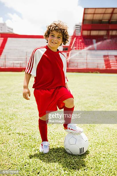smiling soccer player - trikot stock-fotos und bilder