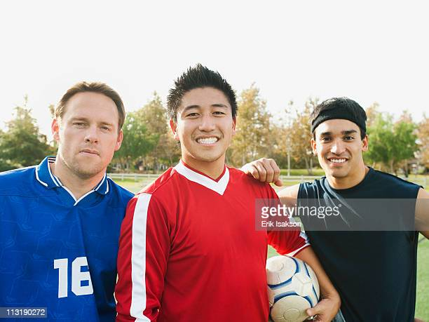 Smiling soccer players with ball