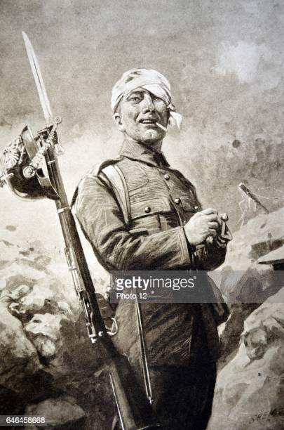 Smiling soldier with a German helmet hanging from his rifle Smoking a cigarette in a trench in World War I 1915