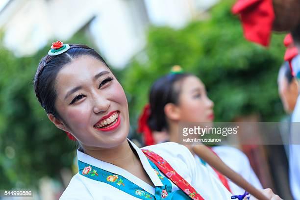 Smiling South Korean girl walking in festival's parade