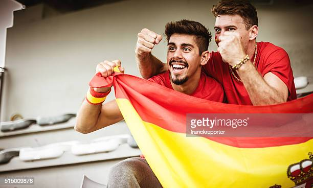 smiling spanish supporter at stadium - hand fan stock photos and pictures