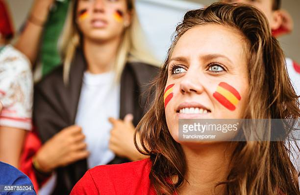 smiling spanish supporter at stadium - fan enthusiast stock pictures, royalty-free photos & images