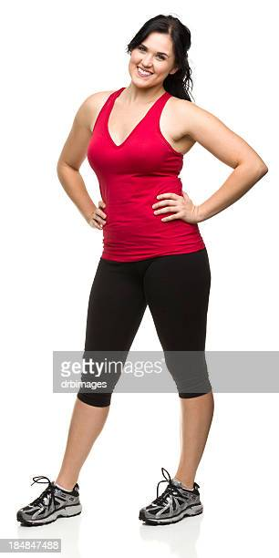 smiling standing young woman in workout clothes - women wearing spandex stock photos and pictures