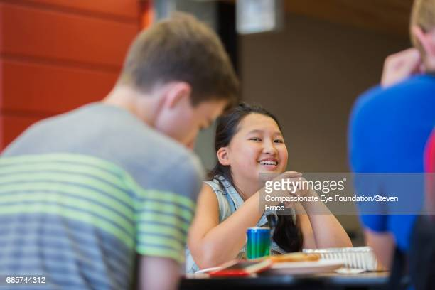 Smiling student in cafeteria