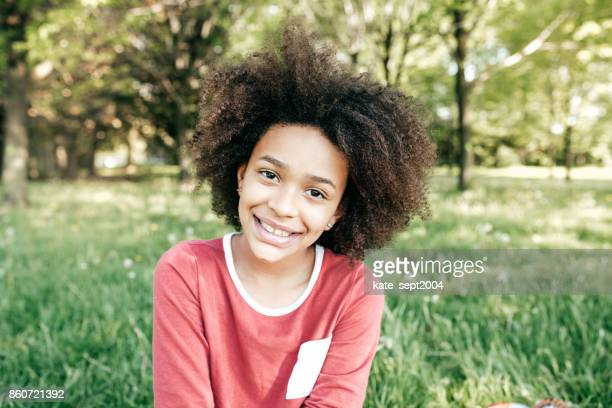 smiling student - 13 year old black girl stock photos and pictures