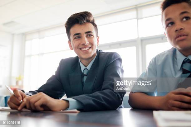 smiling student - uniform stock pictures, royalty-free photos & images