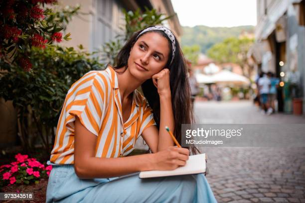 smiling student taking a break - diary stock pictures, royalty-free photos & images