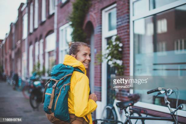 smiling student walking at the street - 20 24 years stock pictures, royalty-free photos & images