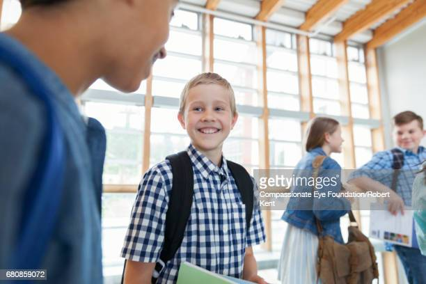 Smiling students in corridor