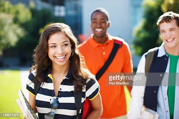 Smiling students walking outdoors