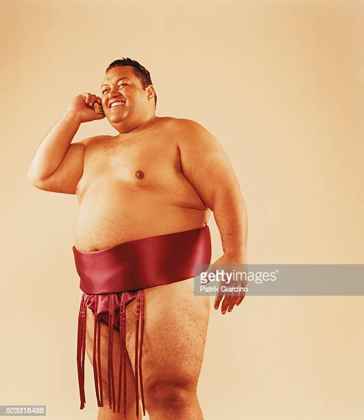 Smiling Sumo Wrestler on Cell Phone