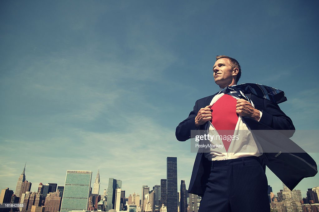 Smiling Superhero Businessman Standing Outdoors City Skyline : Stock Photo