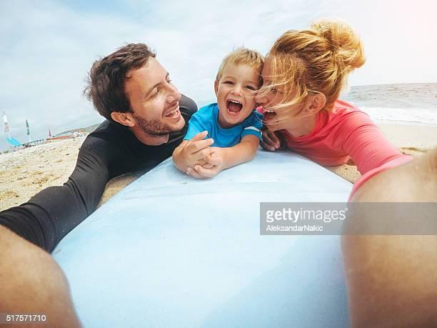 Smiling surfer family