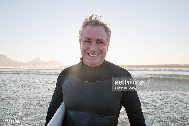 Smiling surfer in water