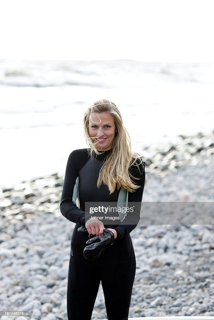 Smiling surfer on beach : Stock Photo