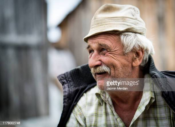 smiling talking senior man - eastern european descent stock pictures, royalty-free photos & images