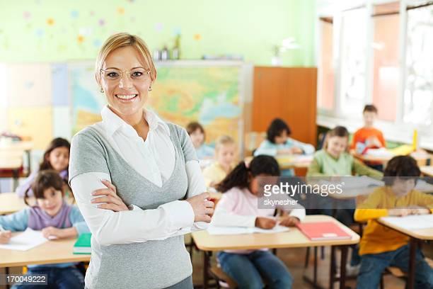 Smiling teacher at the school class