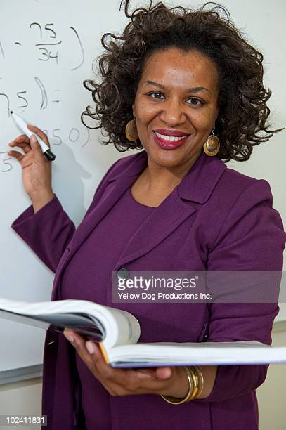 Smiling teacher standing in front of class
