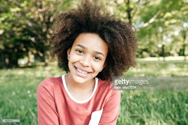 smiling teen girl - 13 year old black girl stock photos and pictures