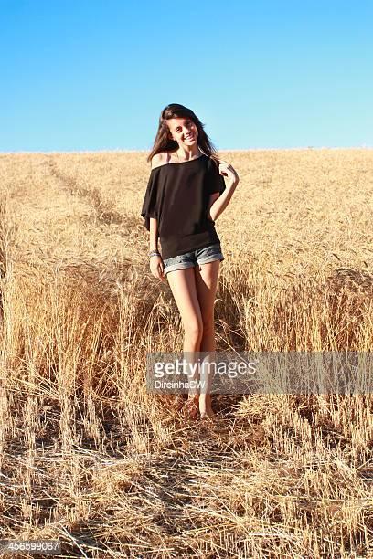 smiling teen in wheatfield - mini shorts fotografías e imágenes de stock