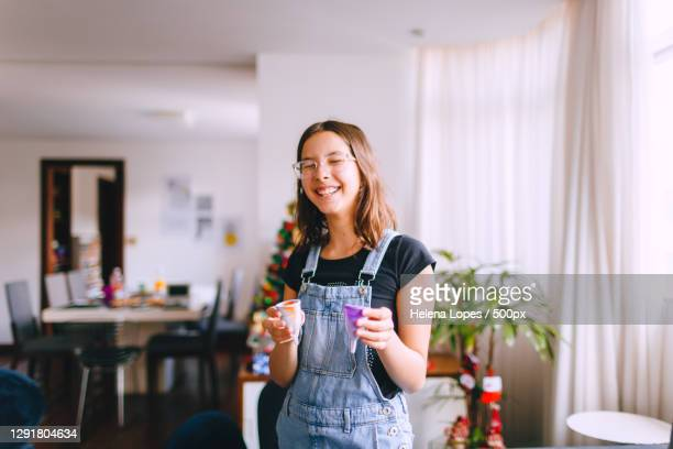 smiling teenage girl holding reusable menstrual cup,belo horizonte,state of minas gerais,brazil - brazil stock pictures, royalty-free photos & images