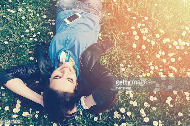 Smiling teenage girl lying on grass