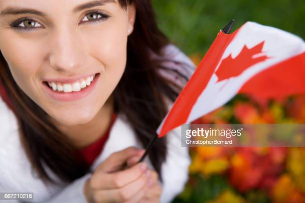 Smiling teenager holding canada flag