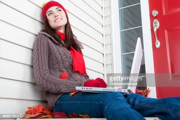 Smiling teenager using laptop