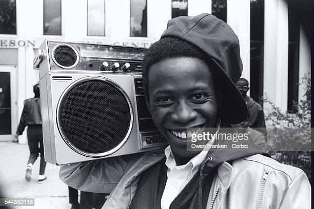 A smiling teenager with a boombox stands outside an AfricanAmerican youth center in Harlem on July 7 the day of a campaign speech given there by Joan...