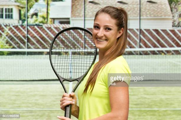 Smiling tennis player at the field