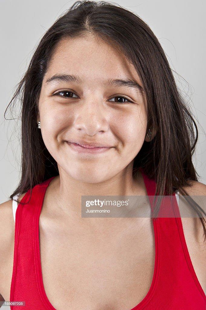 Smiling Thirteen Years Old Hispanic Girl High-Res Stock
