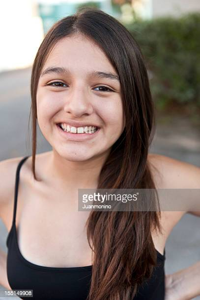 smiling thirteen years old hispanic girl - 14 15 years stock pictures, royalty-free photos & images
