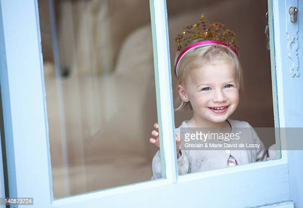 smiling toddler girl wearing tiara - saint ferme stock photos and pictures