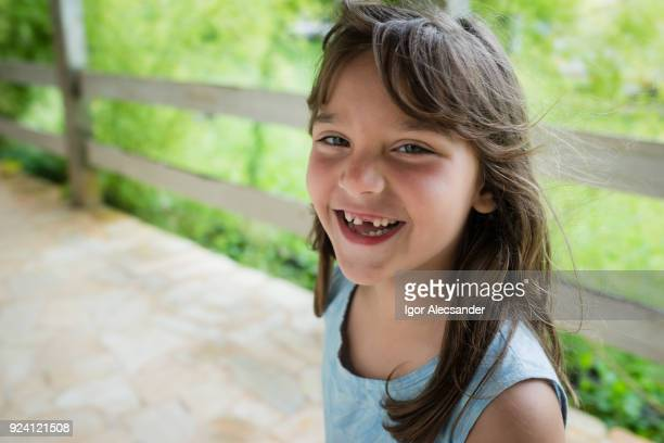 smiling toothless little girl - missing teeth stock photos and pictures