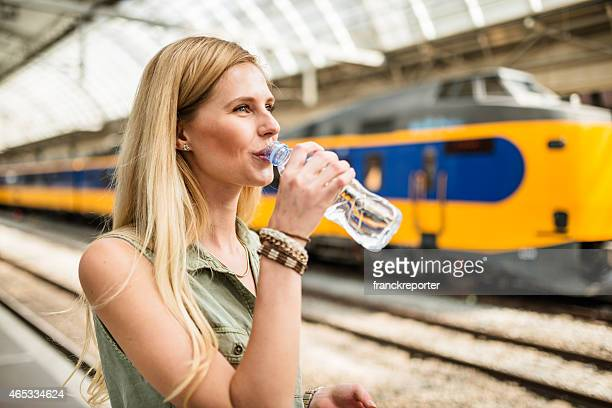 smiling tourist refreshment at the station - refreshment stock pictures, royalty-free photos & images