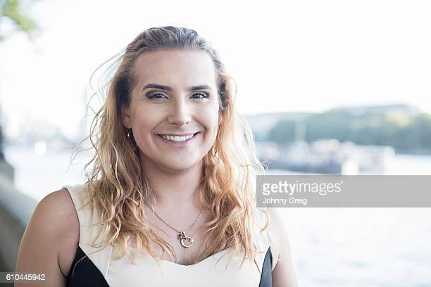 smiling transgender female looking at camera, portrait - transexual stock photos and pictures