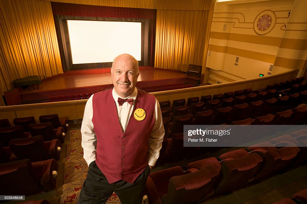 Smiling Usher in Movie Theater : Stock Photo