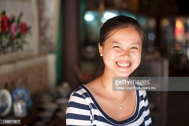 smiling vietnamese woman shop vendor - vietnamese culture stock pictures, royalty-free photos & images
