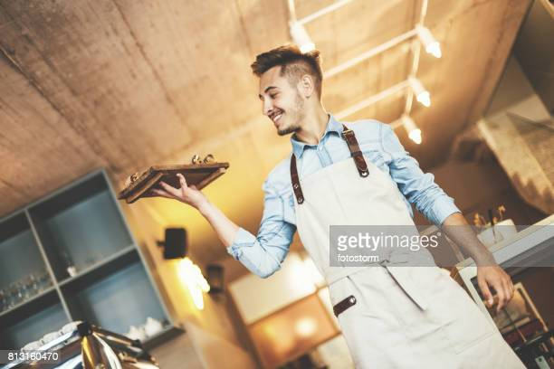 Smiling waiter serving