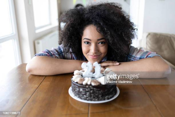 smiling woman and birthday cake with candles - 21st birthday stock pictures, royalty-free photos & images