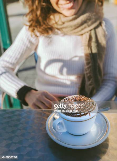 Smiling woman and capuccino