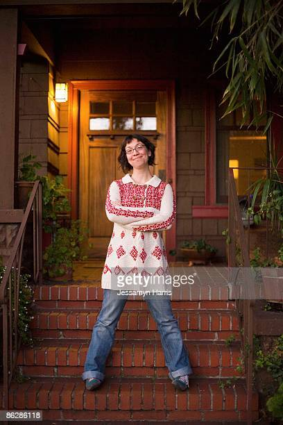 Smiling woman and house