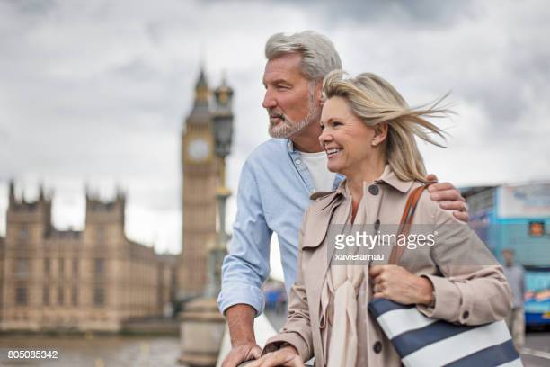 Smiling woman and man against Big Ben