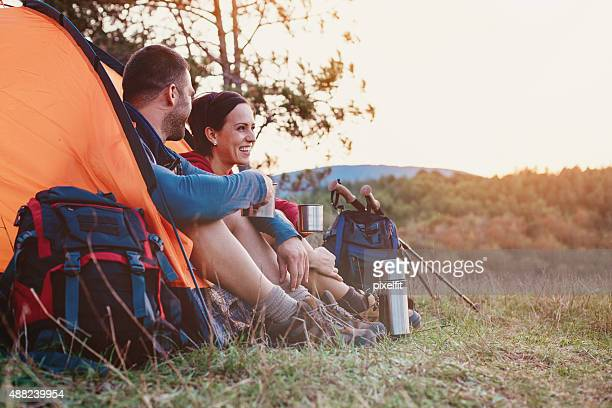 Smiling woman and man resting in the mountain