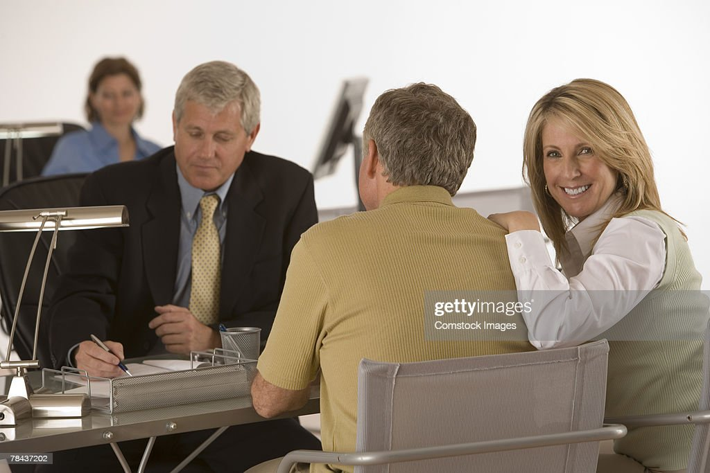 Smiling woman at business meeting : Stockfoto