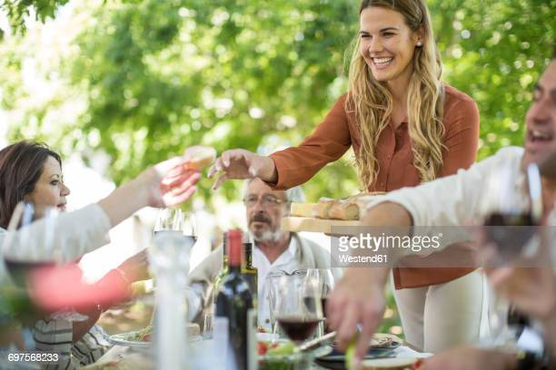 Smiling woman at family lunch in garden