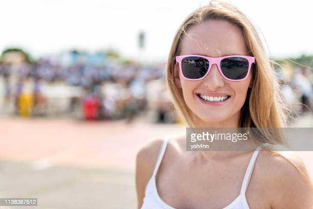 smiling woman at festival - festival goer stock pictures, royalty-free photos & images