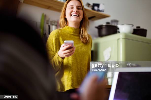 smiling woman at home in morning - lachen stockfoto's en -beelden